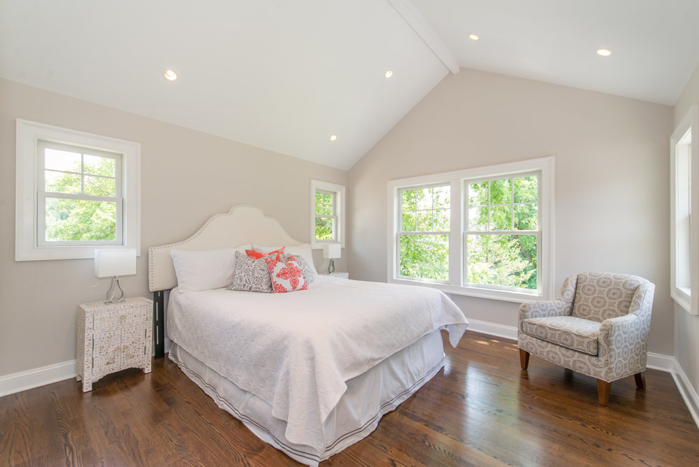 New Master Suite is in the back of the house with raised ceiling and pleasant and private views from 3 sides