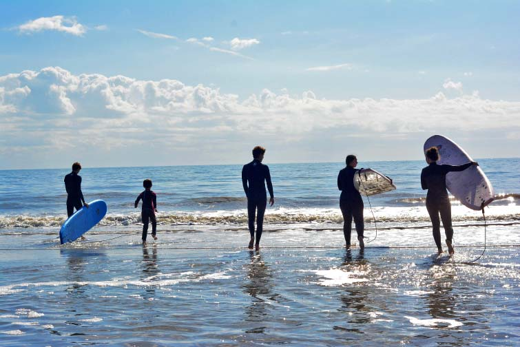 The whole family headed out to surf some fun waves on Folly!