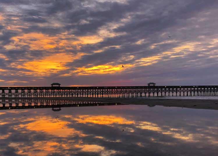A beautiful sunrise at the Folly Beach Pier.
