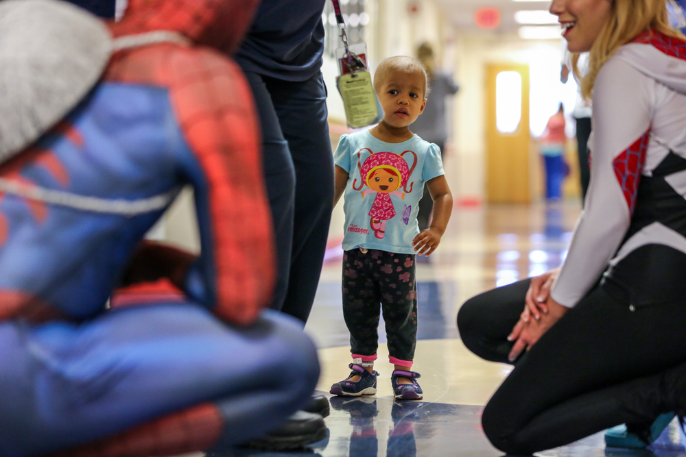 Initially skeptical of Spiderman as he visits the Ocology Department at Children's National, Melody eventually welcomes him.