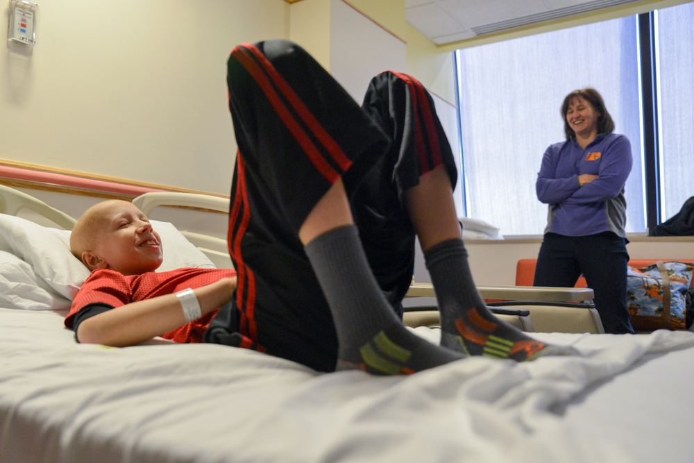 Laughing to fight the nausea, Jimmy eagerly awaits a visit from Spiderman at Children's National.