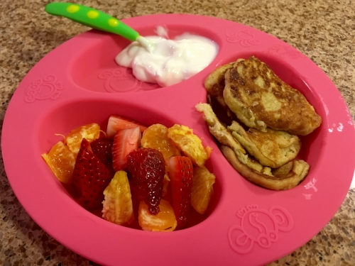 A typical toddler breakfast: 2-3 tablespoons of yogurt, 1/4 cup fruit and 2-3 small pancakes (and it's okay if they don't finish the whole thing!).