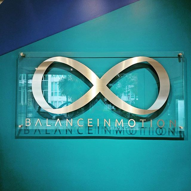 """Signage. 18ga stainless adhered to 1/2"""" acrylic. Installed at @balancemotion new location in Vancouver.  #lasercut #lasercutting #signage #lasercutacrylic"""
