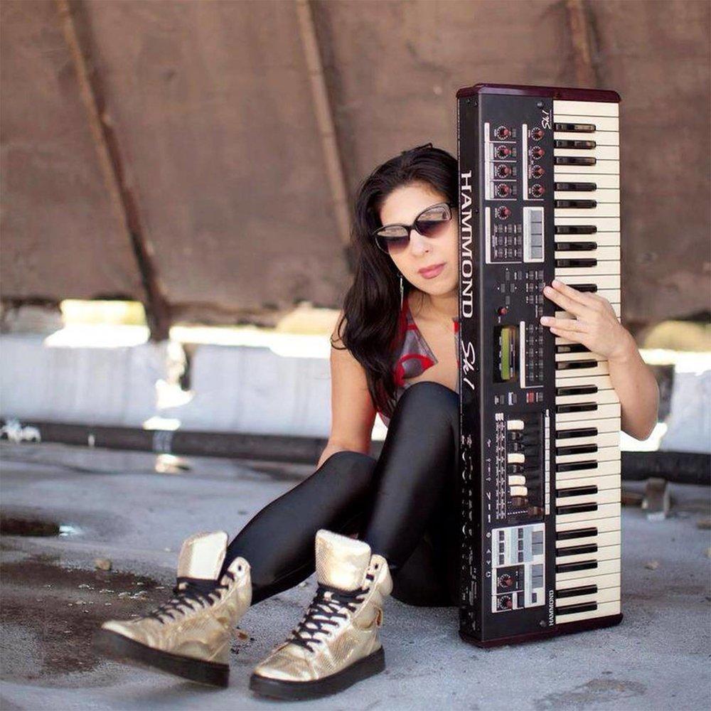 Emiko - Musical Director/Bassist