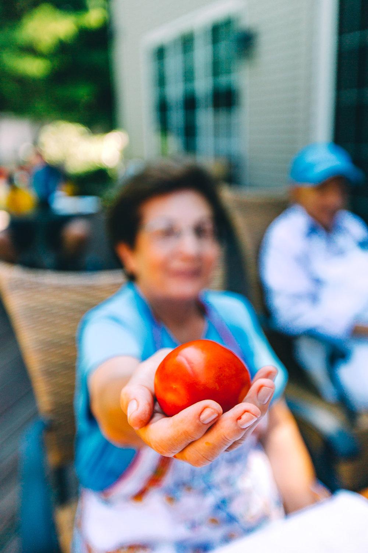 Grandma Handing Tomato (1 of 1).jpg