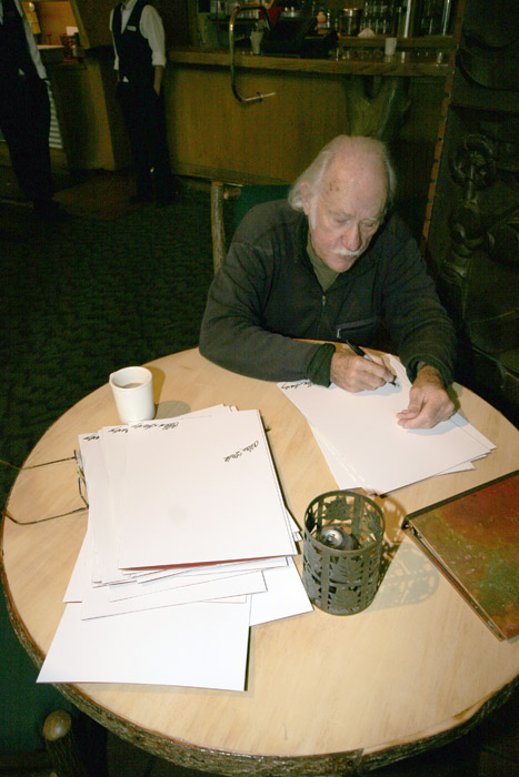 Allen Steck autographing brochures before the Nose reunion. November 8, 2008.