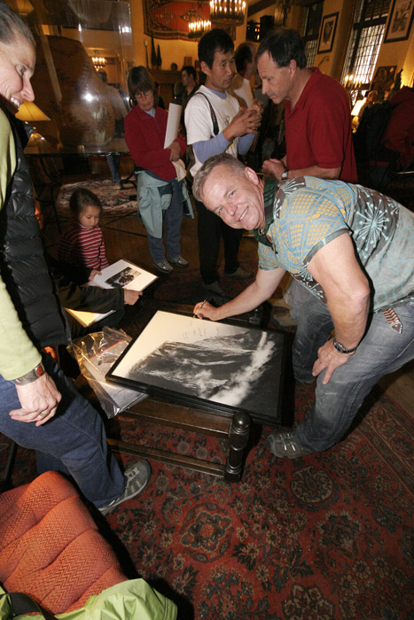 Peter Haan signing an El Cap photo at the Ahwahnee Great Lounge during the Nose reunion.