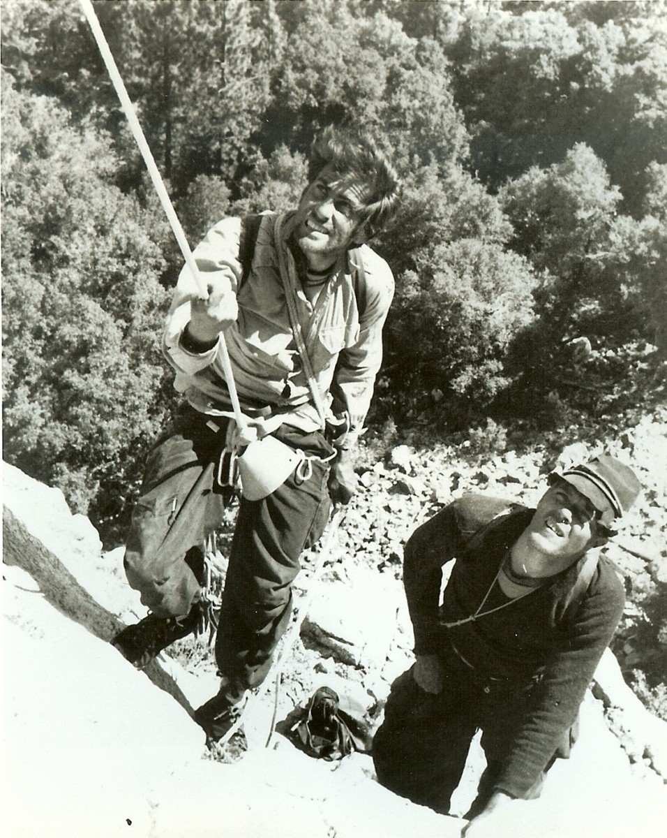"Harding and Powell rappelling off the Nose of El Capitan during the first effort on the first ascent in 1957. Photo by Bill ""Dolt"" Feuerer."