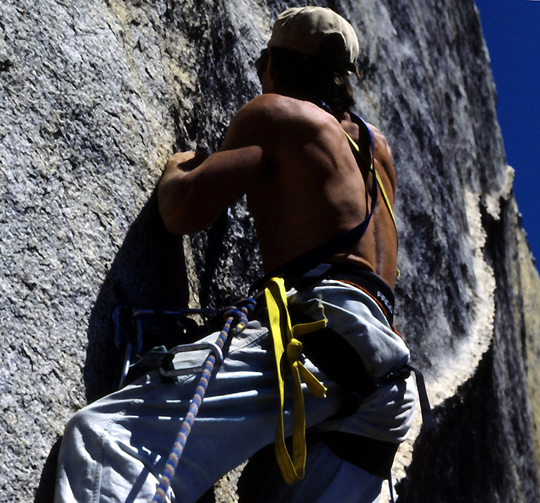Jim Campbell drilling a belay bolt at the end of the Walking the Plank (4th) pitch. The Yardarms (crux pitch) is next with an endless dike beyond.Ken Yager photo..jpg