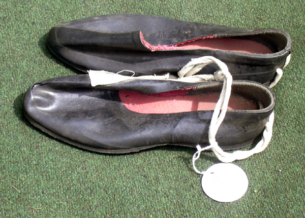 Russian Free Climbing Slippers.  These rubber coated slippers were popular with russian climbers of the 1970's. Donated by Loyd Price.