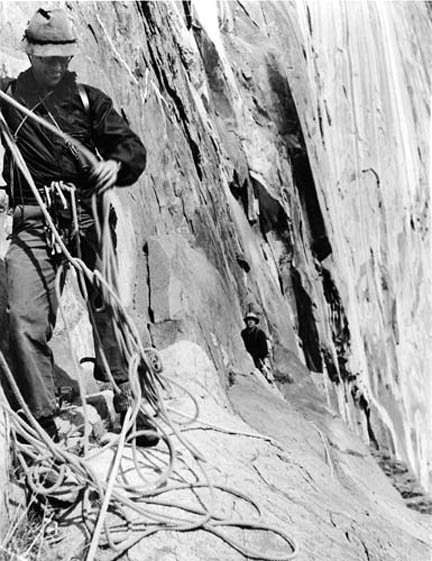 Al Steck in a tangle of rope with Will Siri in the background during the first ascent of El Cap Tree in 1952. Photo by Bob Swift.