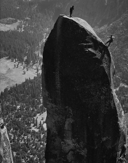 John Salathe taking a picture of Ax Nelson rappelling after completing their 4 1/2 day first ascent of Lost Arrow Chimney, 1947. Photograph by Ansel Adams. This photo can be seen in the Granite Frontiers exhibit and was loaned to the Yosemite Climbing Association by Michael and Jeanne Adams.