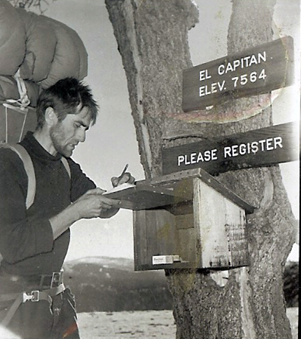 Harding signing the El Capitan summit register after the first ascent. November 12, 1958.