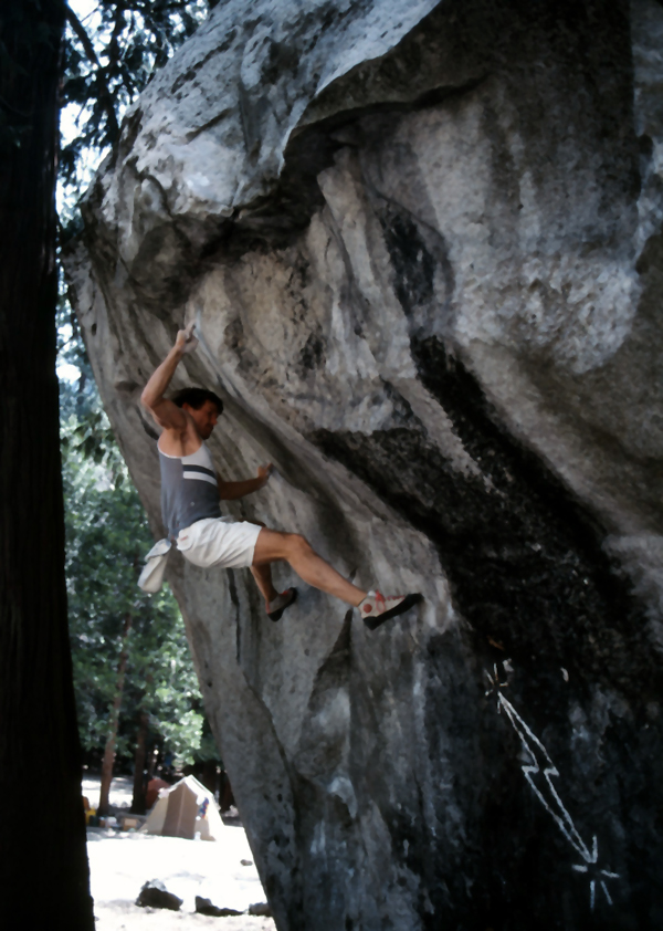 Yabo climbing Midnight Lightning, circa late 1980's. Yabo was the first person to envision this boulder problem even though he did not get the first ascent.Photo by Ken Yager