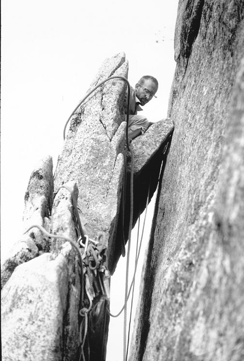 Royal Robbins perched on a belay ledge during the first ascent of the Mozart Wall on Sentinel Rock, 1962. Photo by Tom Frost.