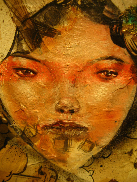 Woman's face detail on a piece by David Choe