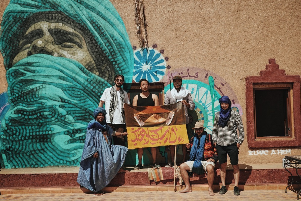 El Mac ,  David Choe ,  Andrew Hem ,  Mars-1 , and  Esao Andrews  with Hssain Ahnana, respected leader in Merzouga and subject of El Mac's portrait for the  Igloo Hong  project