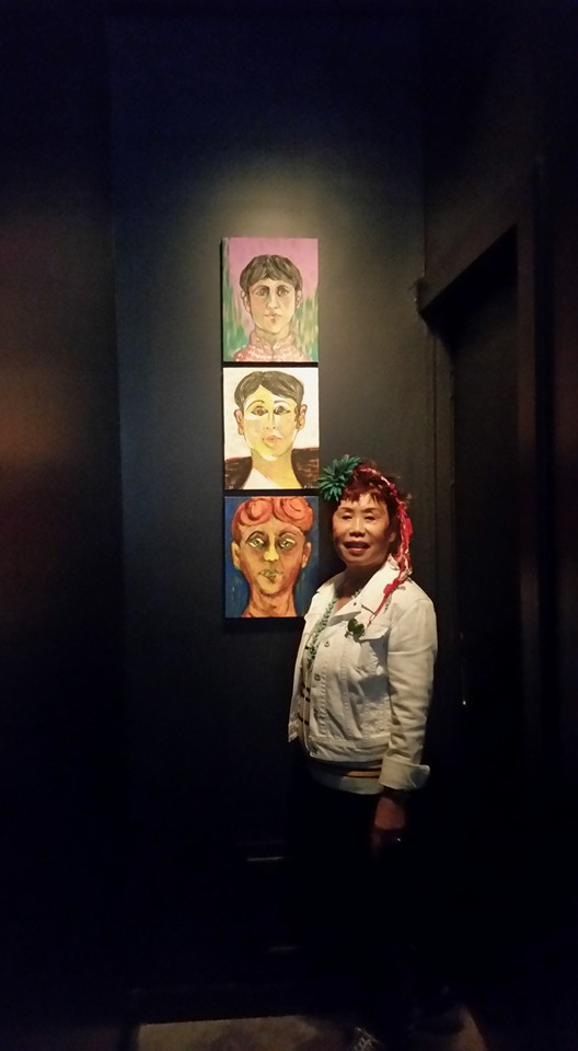Artist Jane Choe, mother of David Choe, with her self-portrait paintings