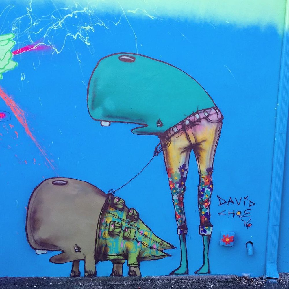 David Choe mural featuring two munkos
