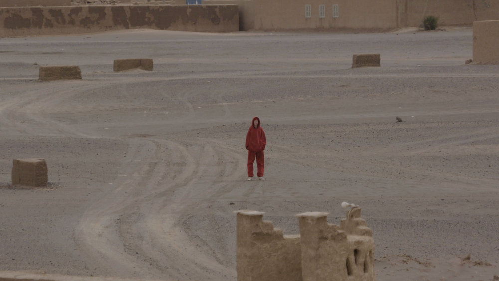 Man in a red hood, Igloo Hong, Morocco