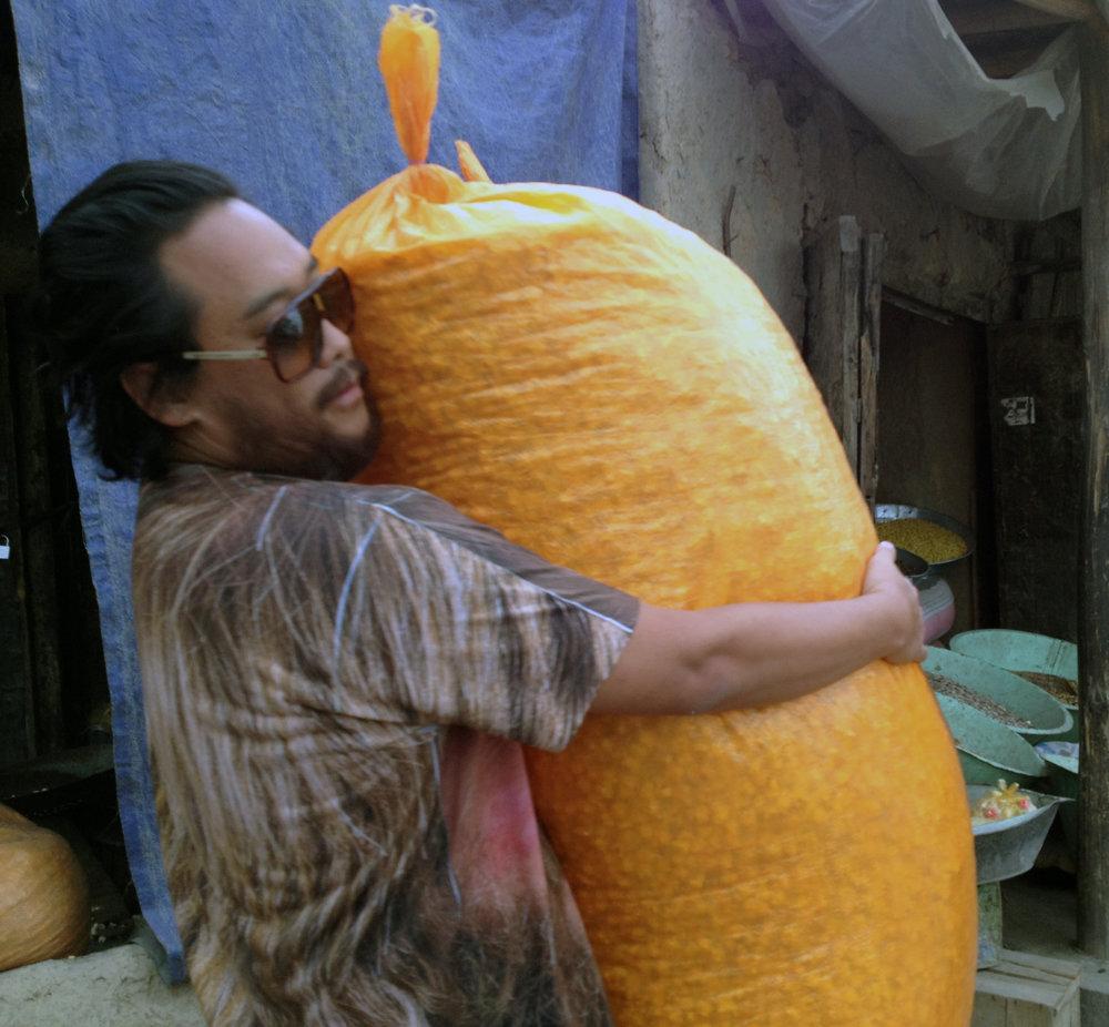 David Choe hugging popcorn, Afghanistan, 2013