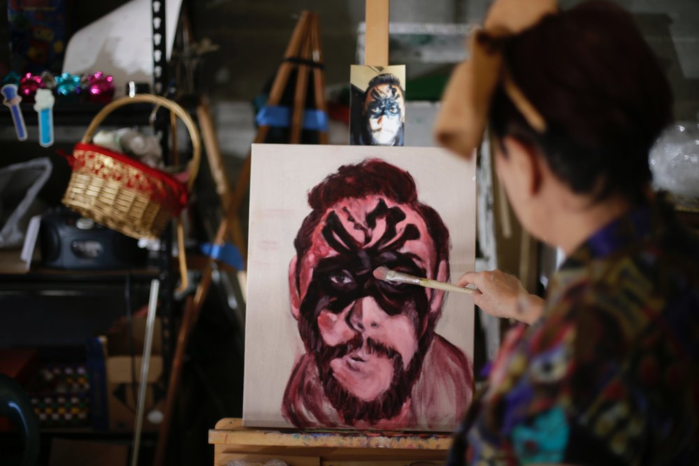 Artist Jane Choe painting a portrait of her son, artist David Choe