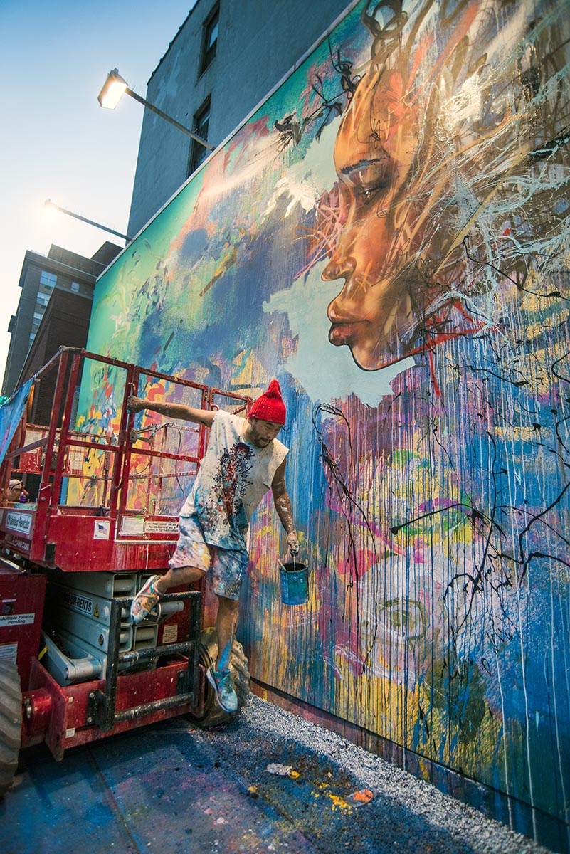 David Choe painting at the Bowery Wall New York. Photo by Martha Cooper.