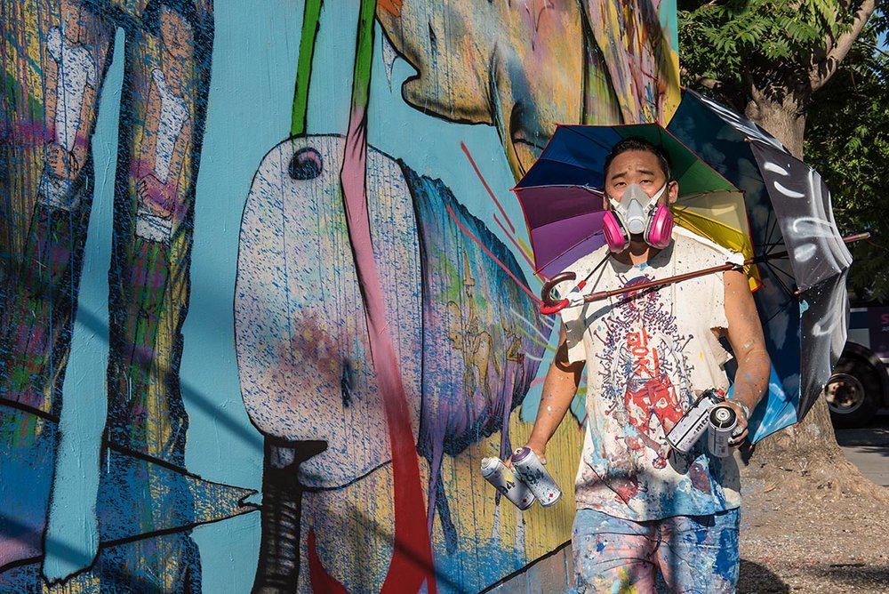 Artist David Choe painting a mural at the Bowery graffiti wall in New York. Photo by Martha Cooper.