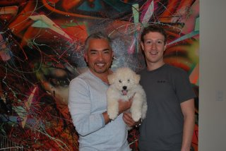 Dog whisperer Cesar Millan with Mark Zuckerberg of Facebook in front of David Choe mixed media art