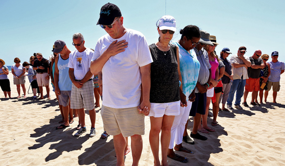 Jay Fagnano, center left, and his wife, Mary, center right, join family and friends in remembrance of their son Nick Fagnano on the one-year anniversary of his death caused by lightning in Venice. MORE
