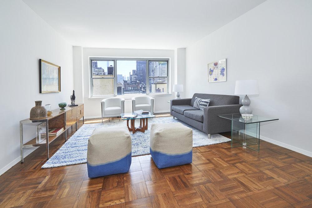 6769975-8 East 83rd street-8E-2-Living room-AM.jpg
