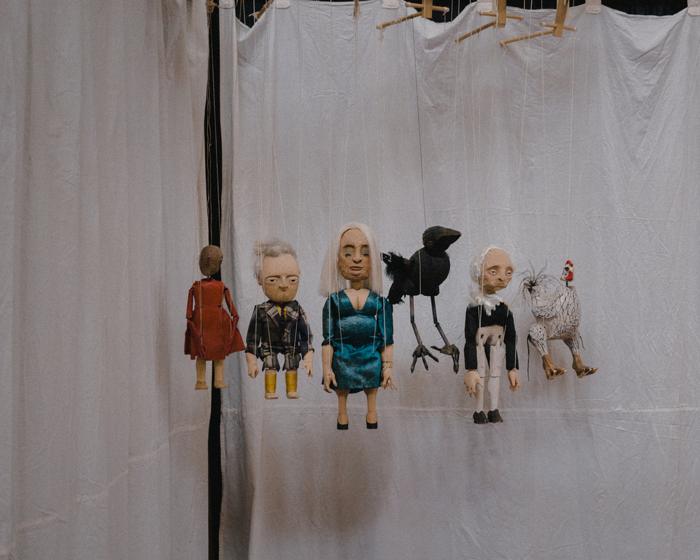 Marionettes by Niki Ulehla straddle the line between caricature and surreal.