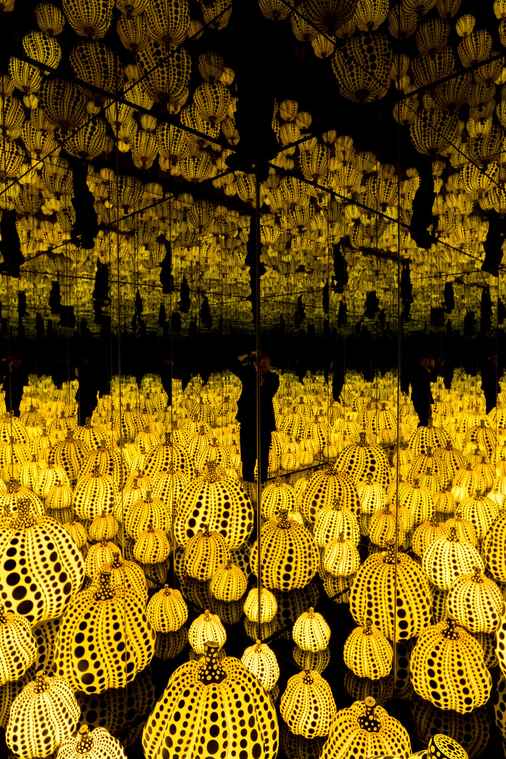 The absurd and inspiring interior of  Infinity Mirrored Room —  All the Eternal Love I Have for the Pumpkins .