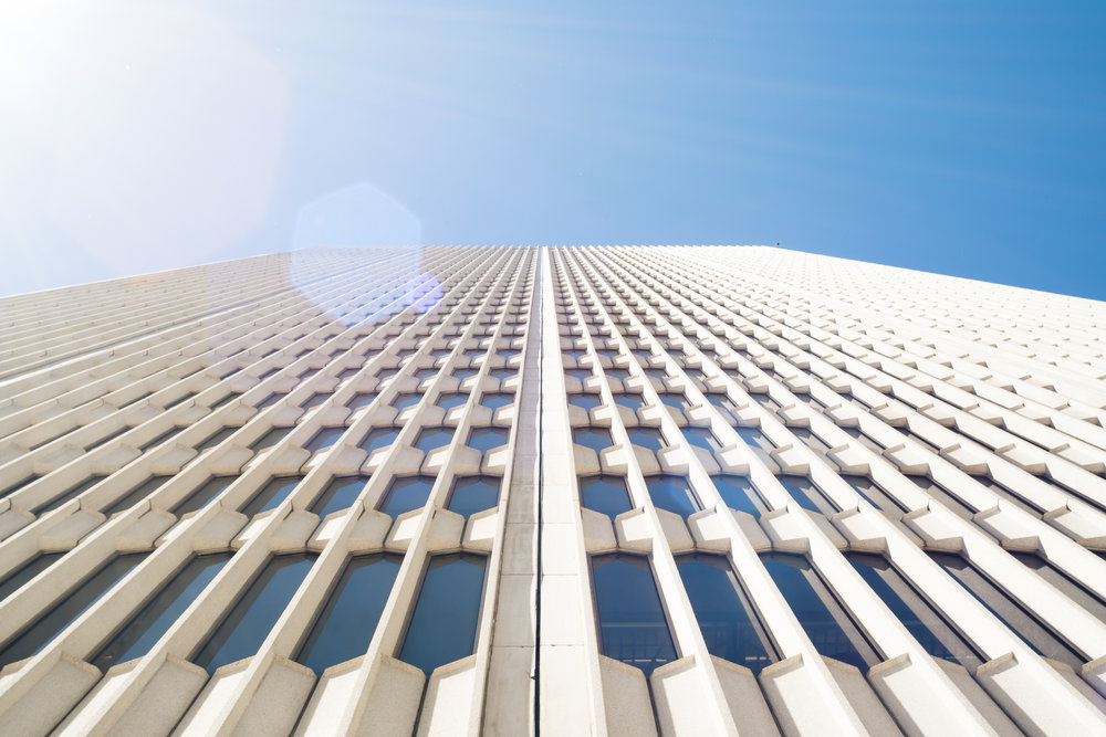 One Woodward  was designed by architect  Minoru Yamasaki  in 1962 as the headquarters for the Michigan Consolidated Gas Company. Originally known as The Michigan Consolidated Gas Building, it was his first skyscraper, and he used elements from this design in another pair of famous buildings which are no longer standing: the twin towers of the World Trade Center in New York City.