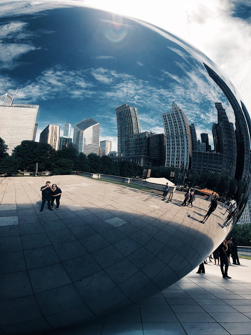 My friend  Jen  and I, reflected in  Cloud Gate , by Indian-born British artist  Sir Anish Kapoor .
