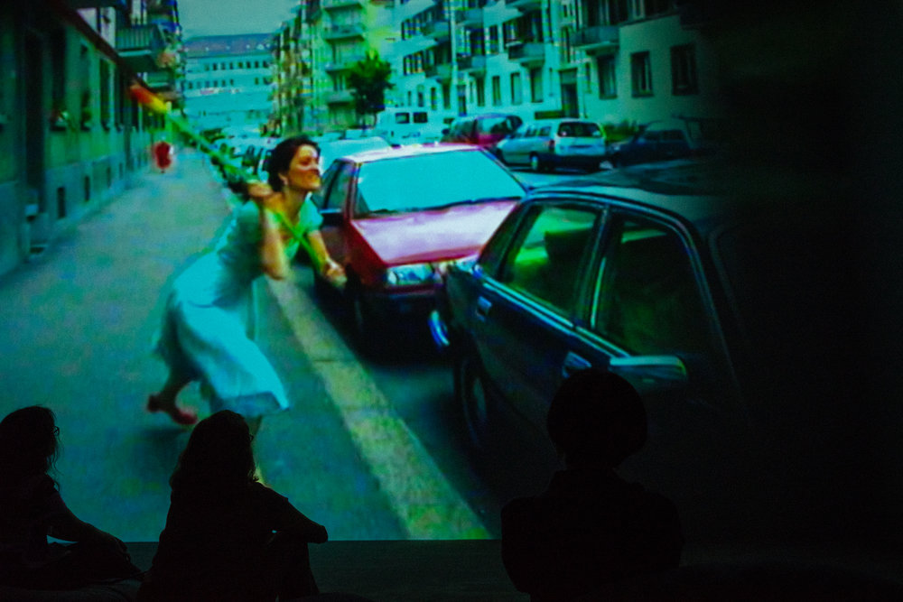 Two photos from from  Pipilotti Rist' s,  Ever Is Over All , which may look familiar to you since it was the inspiration for the video   Hold Up  , by Beyoncé.