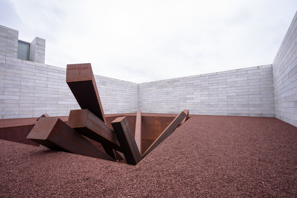 Don't even get me started on how amazing this piece is.  Collapse  is one of two  Michael Heizer  installations at Glenstone. This installation is a weathered steel sculpture comprised of fifteen massive beams arranged in a cavernous, topless box stuck into the earth.