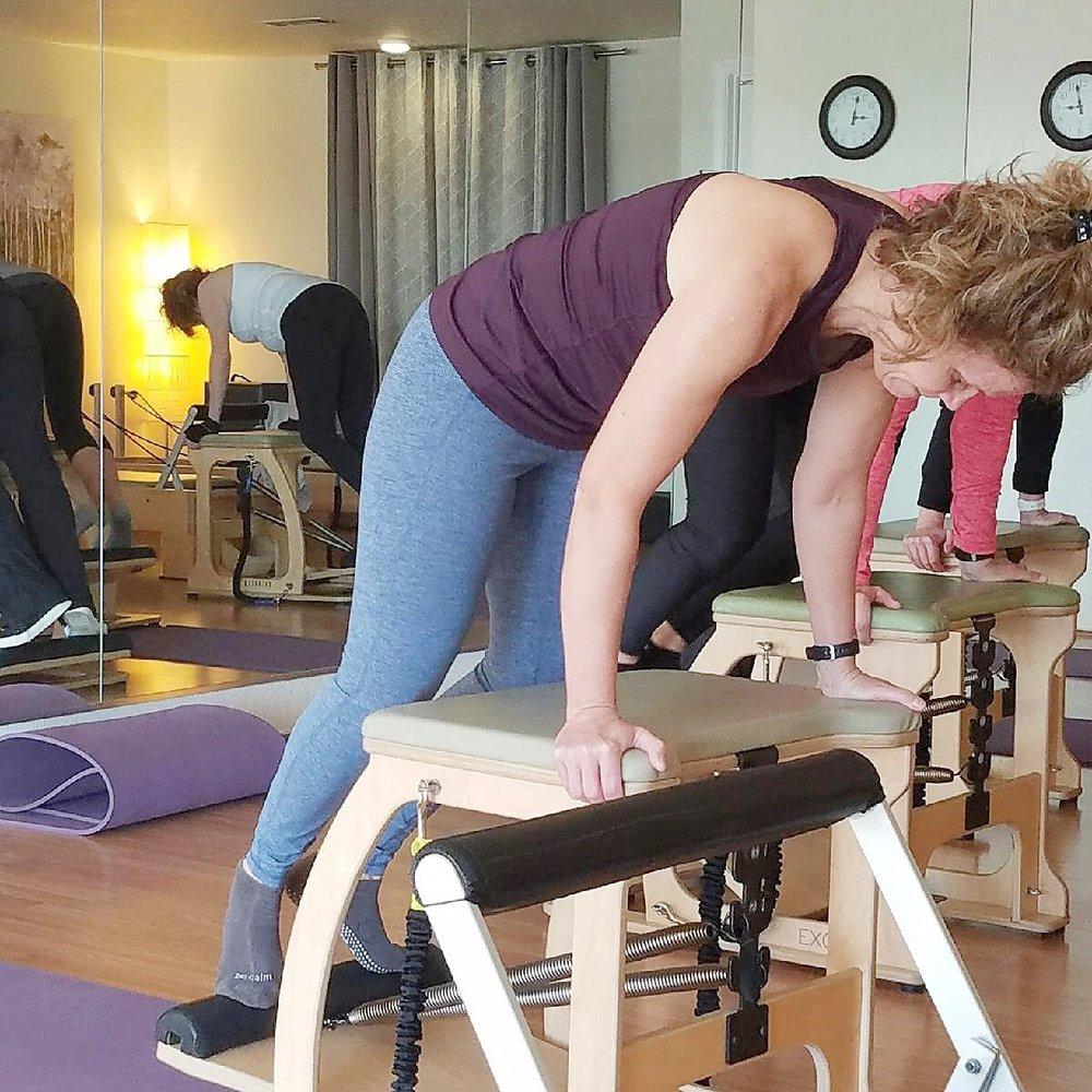 "Beth in Pilates class. Wunda chair ""pike""."