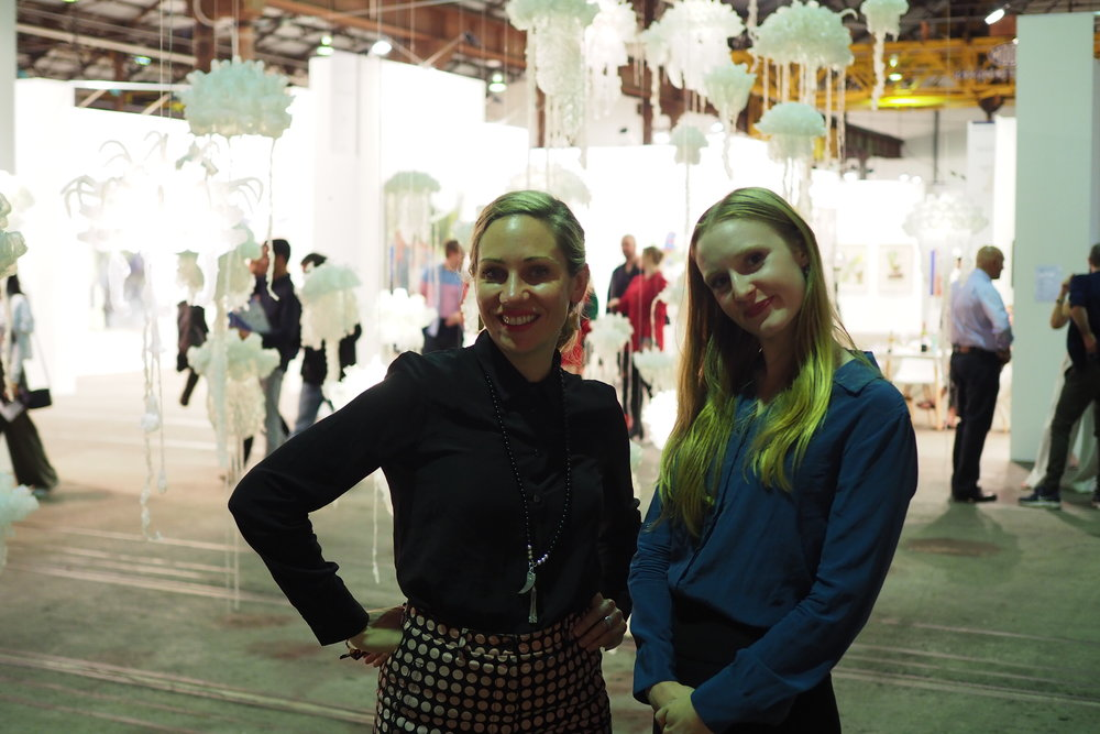 Art Pharmacy Consulting director, Emilya Colliver (L) & Strategic Operations Manager, Hannah Molyneux (R) next to Penelope Davis 'Sea Change', Sydney Contemporary 2018, CREDIT Art Pharmacy Consulting