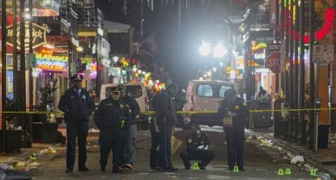 New Orleans police study the crime scene after a fatal shooting on Sunday. (Matthew Hinton/The Advocate via AP)