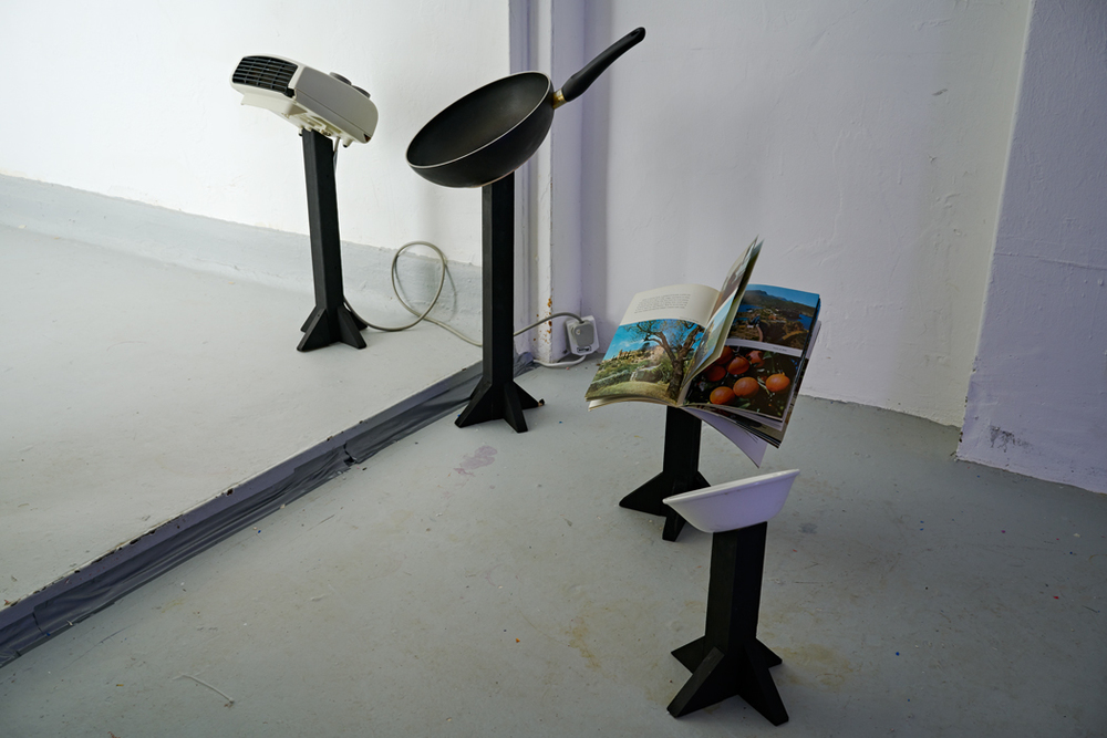 Dialogue with a stolen area heater and a chorus of attendant objects, in which the area heater and the chorus were sung to, and then the singing was replaced by a roving light line