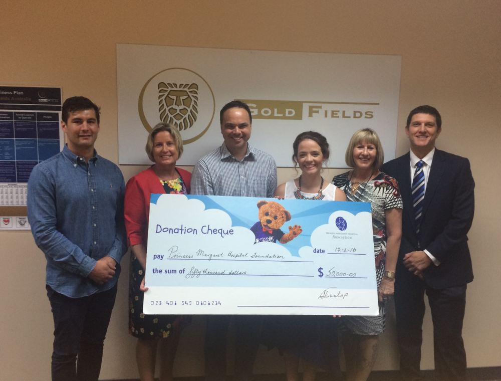 The Emerging Leaders in Philanthropy (ELiP) accept a cheque from Gold Fields Australia Foundation for the PMH Foundation. From left to right:Cameron Waugh (KPMG, ELiP team member),Sharon Warburton (Brookfield Australasia, ELiP Champion),Dr Gareth Baynam (recipient),Hannah Atkins (Herbert Smith Freehills, ELiP Team Member),Sheila Dunlop (Gold Fields),Daniel Whiston (NS Projects, Team Leader of ELiP Team Leader).