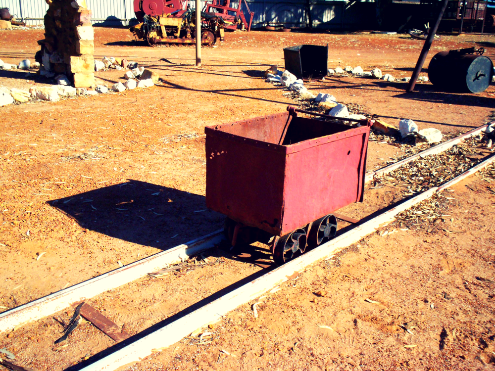 Old underground ore carriage used to push along the tracks to the shaft platform by a miner or alternatively pulled by a small and narrow train engine.