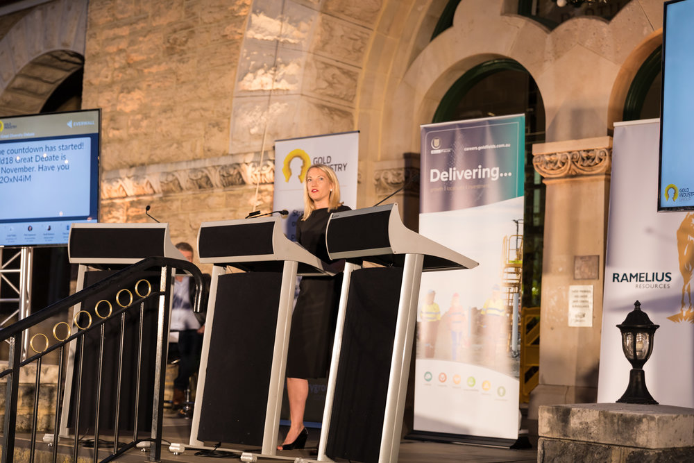 GIG Vice Chairperson and Gold Fields' Vice President of Legal and Compliance Kelly Carter addresses the crowd as adjudicator and Madam Chair of the second annual Women in Gold Great Diversity Debate.
