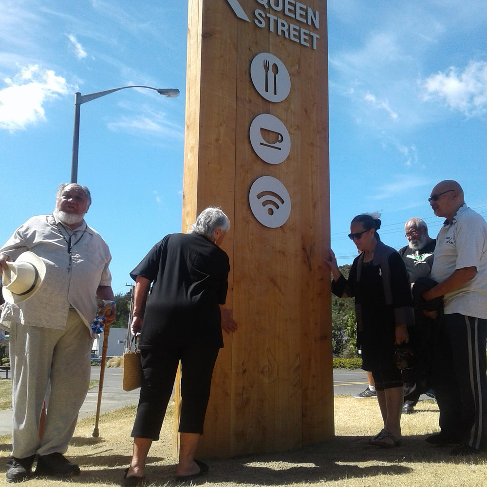 queen st is the vibrant heart of our community, and this sign welcomes locals & visitors. the wood reflects our beautiful envrionment and the teardrop carving honours the story of wainuiomata. Kaumatua provided a blessing for this taonga.