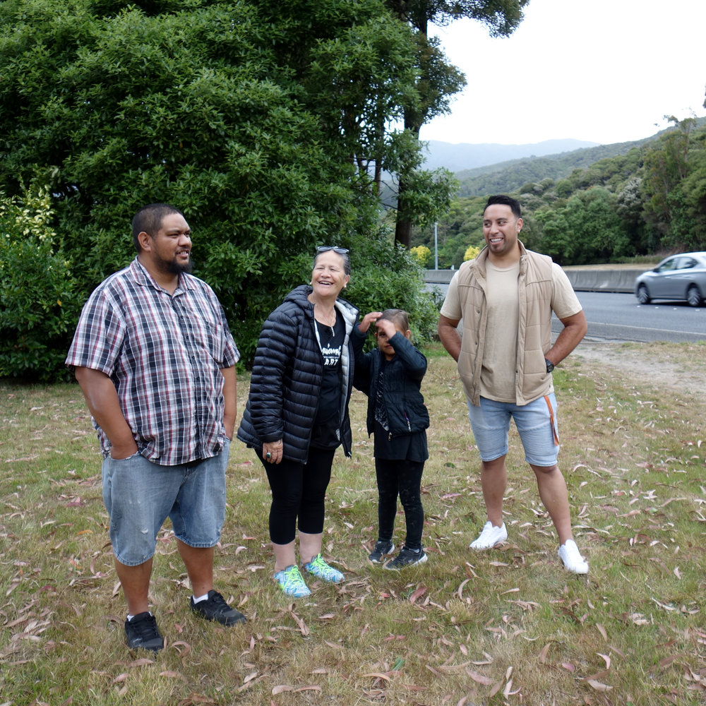 Having a hui about developments for the Wainuiomata welcome sign - Rikki (Carver), Linda (Competition Judge, Wainuiomata Marae Manager), Armani, Tamariki (designer & carver).