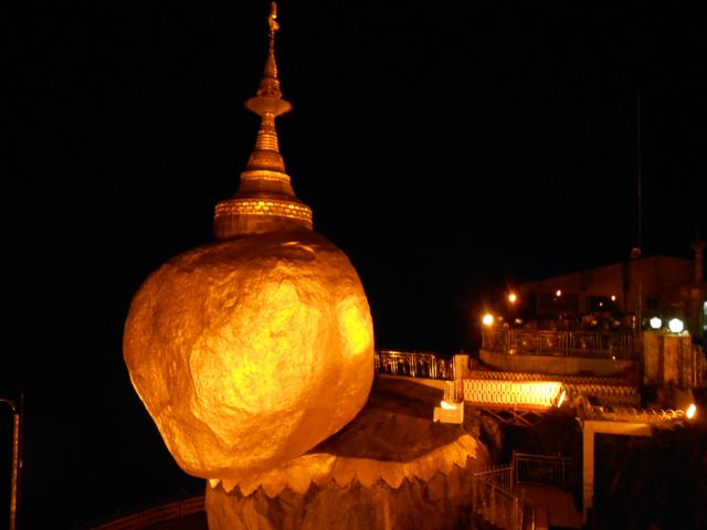 Golden rock at night