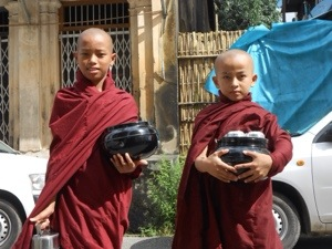 Young Burmese Buddhist Monks on donation day