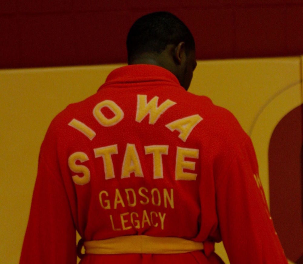 Kyven Gadson is wearing his dad Willie Gadson's wrestling robe in the ISU wrestling room. The robe has served as inspiration for the Cyclones to potentially bring back the robes.