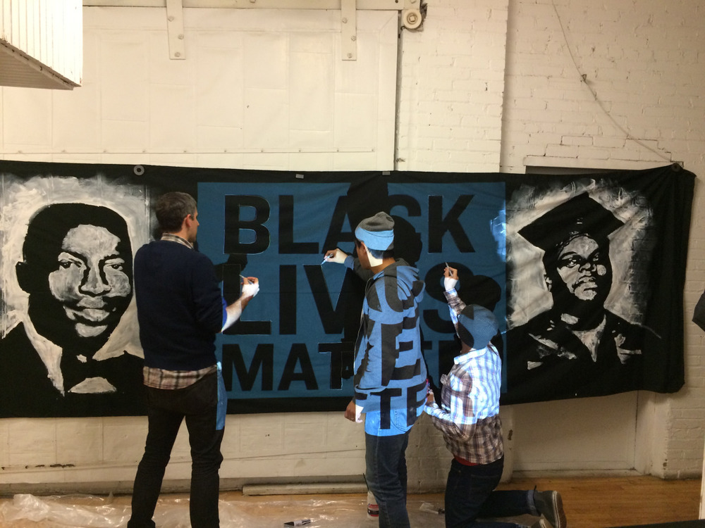 MAKESH!T members creating the BLM banner.